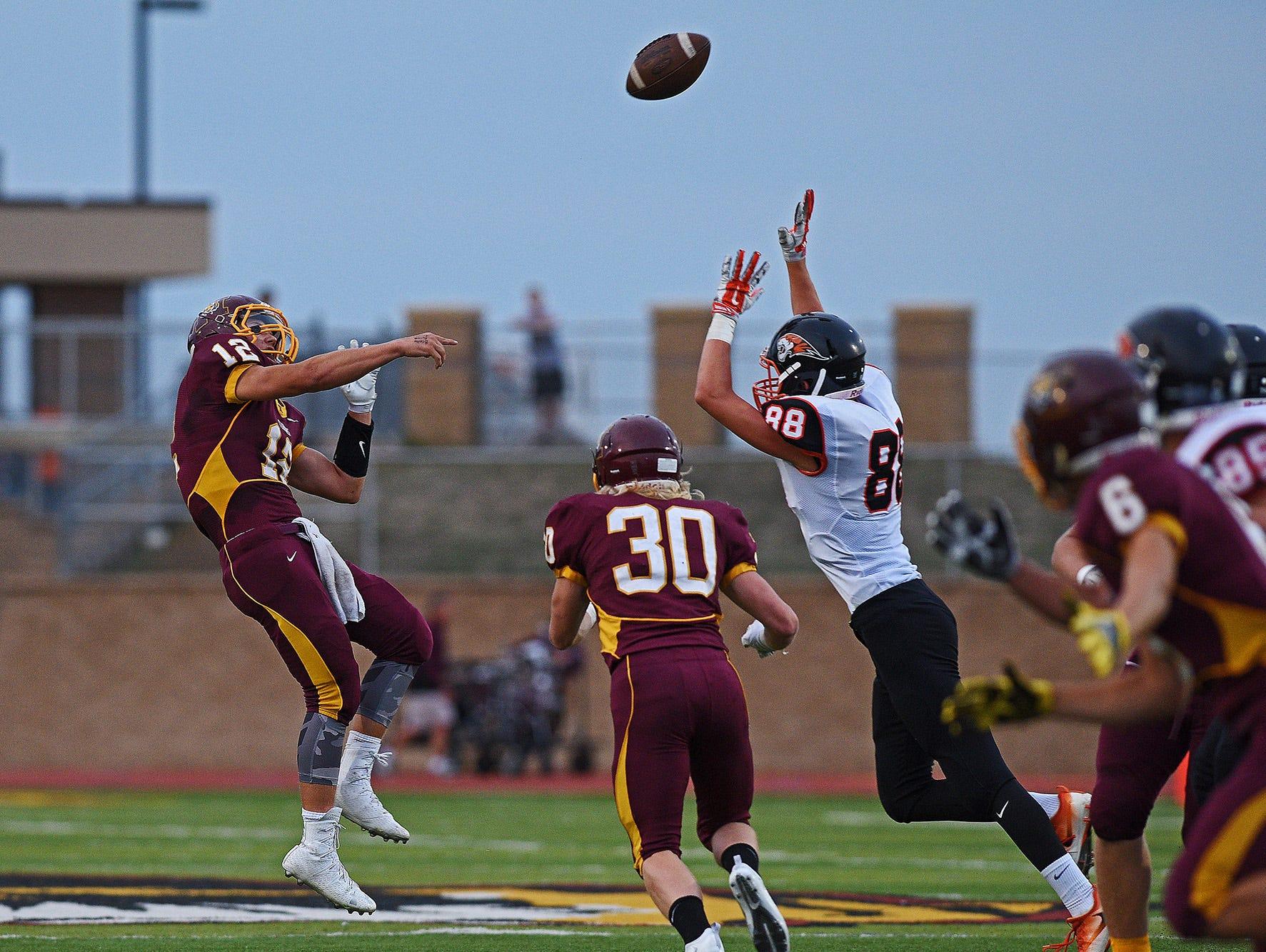 Harrisburg quarterback Hunter Headlee (12) throws a pass during a game against Huron at Harrisburg High School Friday, Sept. 2, 2016, in Harrisburg, S.D.