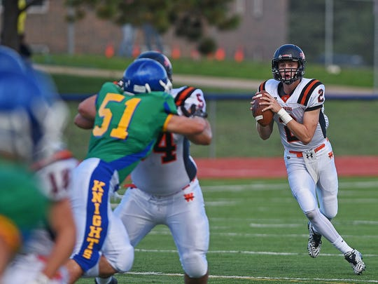 Washington's Jayden Johannsen (2) looks for an open receiver during a game against O'Gorman Friday, Sept. 16, 2016, at McEneaney Field on the O'Gorman High School campus in Sioux Falls.