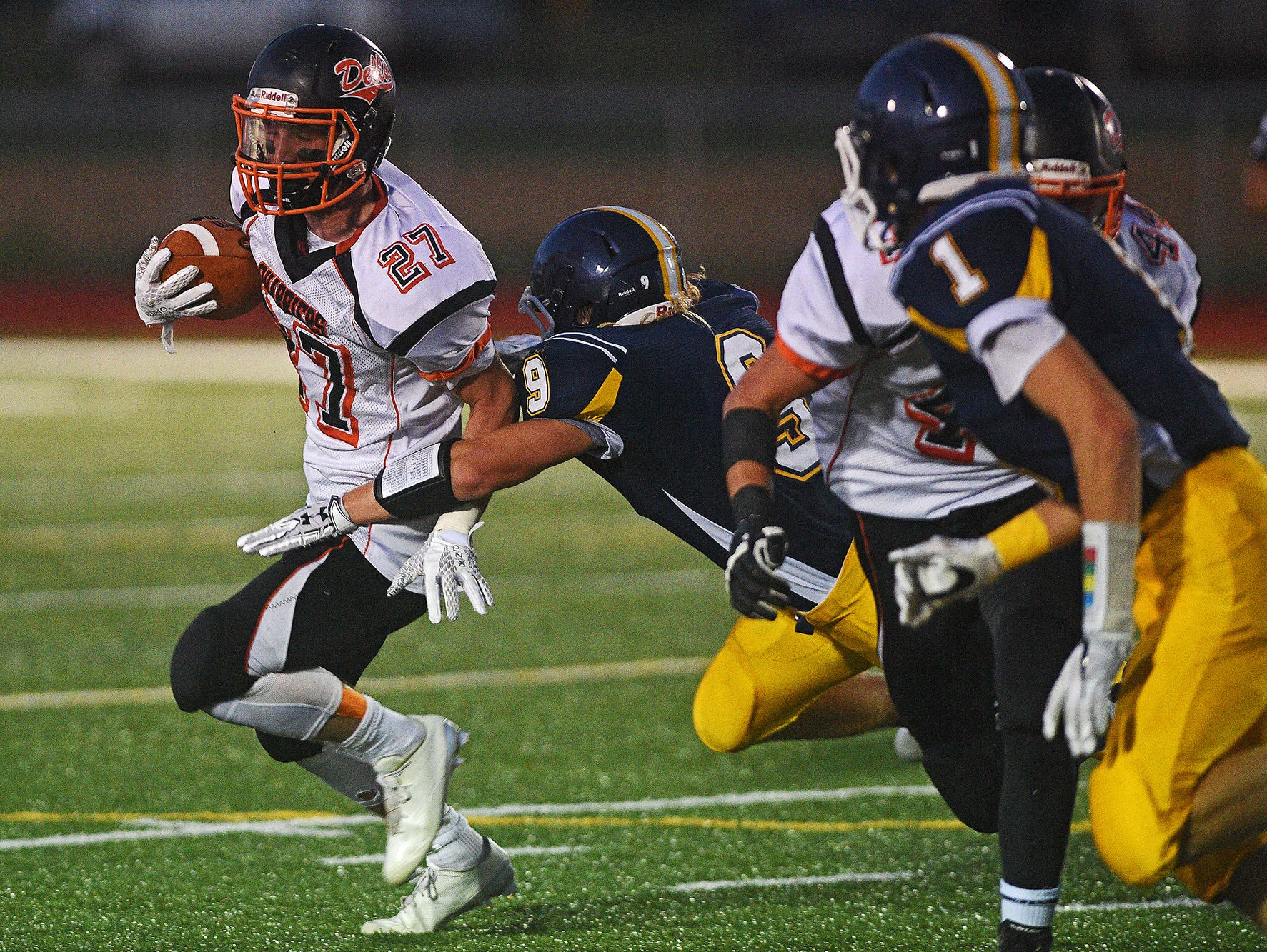 Dell Rapids' Seth Andersen (27) carries the ball as Tea Area's Logan Hoon (9) tackles him during a game Friday, Sept. 16, 2016, at Tea Area High School in Tea, S.D.