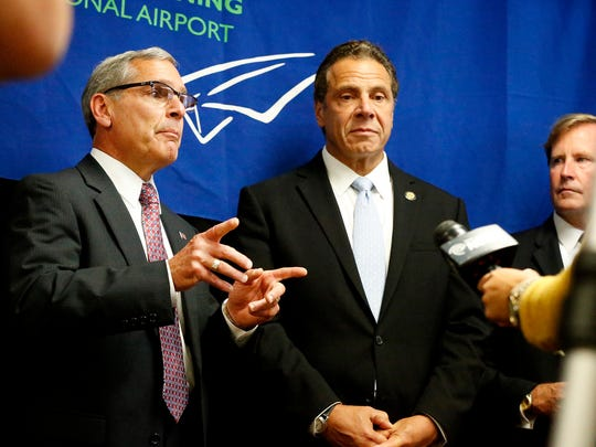 Chemung County Executive Tom Santulli, standing next to New York Gov. Andrew Cuomo, speaks about how the $40 million award will benefit the Elmira Corning Regional Airport and the county in general Wednesday.