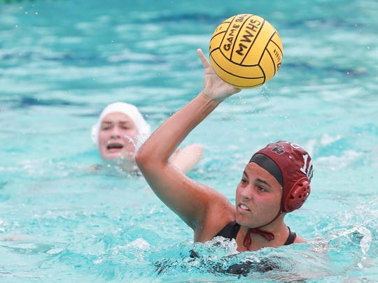Mt Whitney's Lilian Dinis (10) prepares to score against Reedley in the Central Section Division III girls water polo championship game.