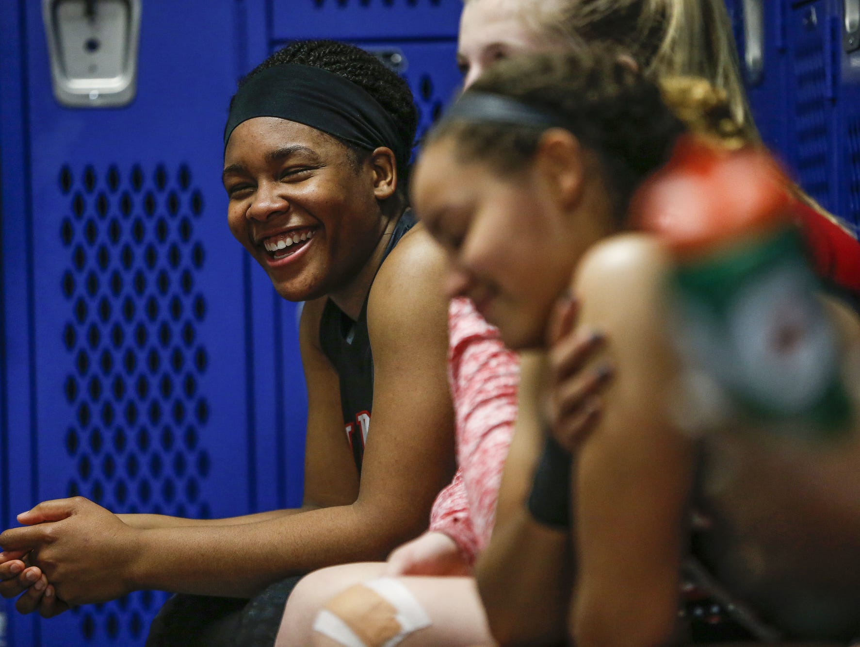 North Central Panthers' Ajanae' Thomas (34) laughs alongside her teammates after the Panthers' victory over the Carmel Greyhounds at Carmel High School on Friday, Dec. 16, 2016.