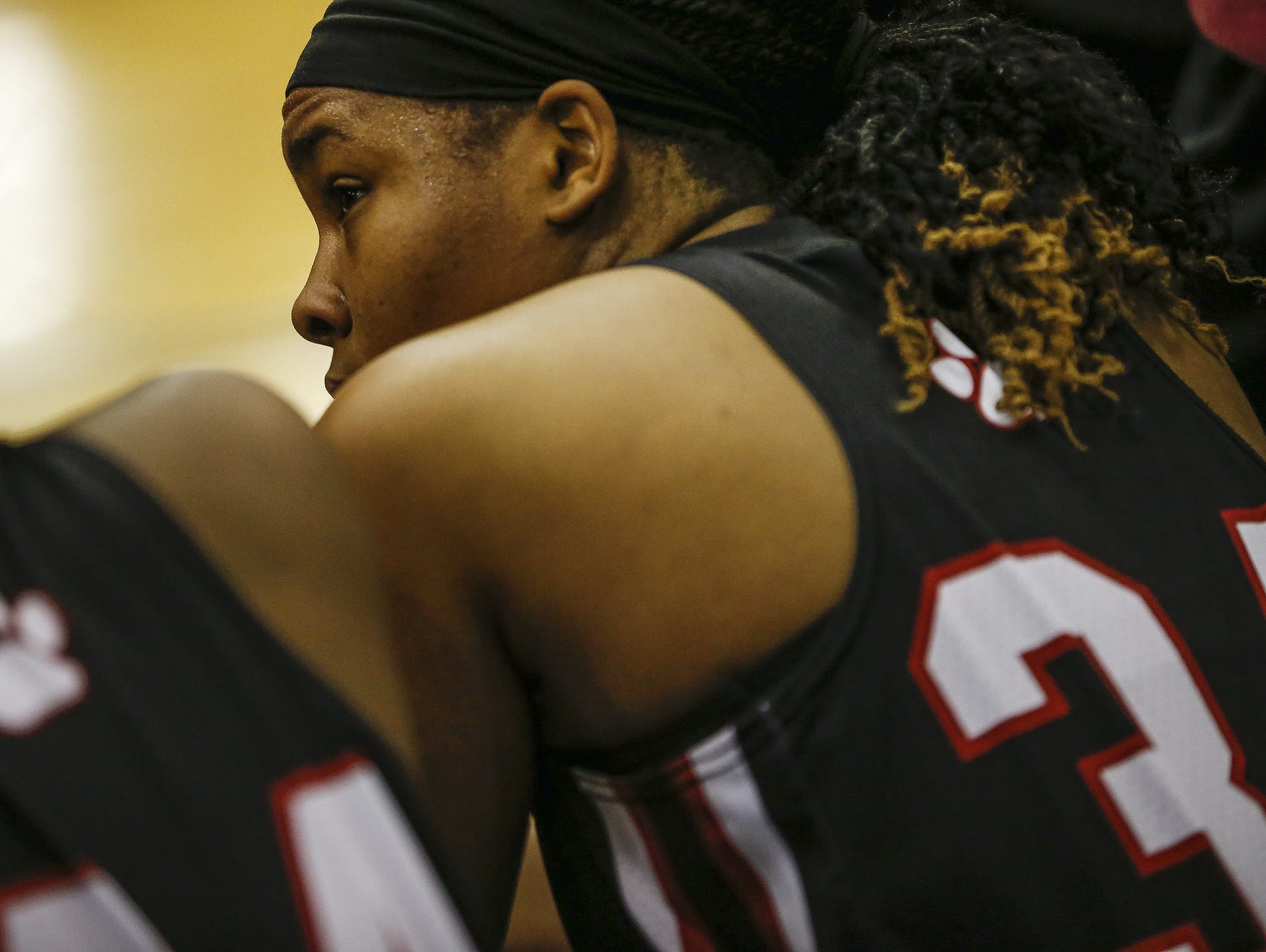 North Central Panthers' Ajanae' Thomas (34) listens as head coach DeeAnn Ramey talks during a timeout in a game against the Carmel Greyhounds at Carmel High School on Friday, Dec. 16, 2016.