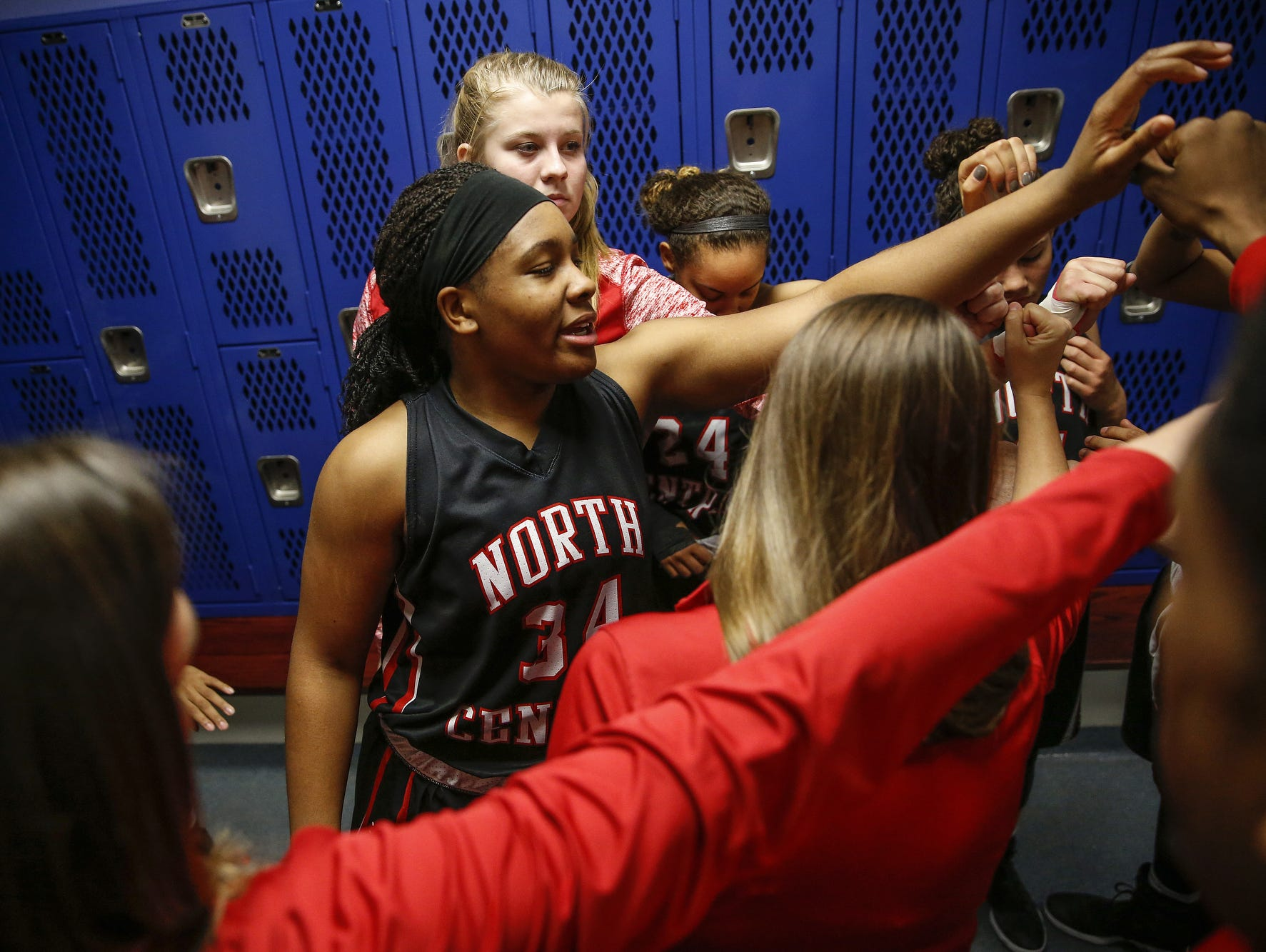 North Central Panthers' Ajanae« Thomas (34) breaks a huddle with her team after the Panthers' win against the Carmel Greyhounds at Carmel High School on Friday, Dec. 16, 2016.