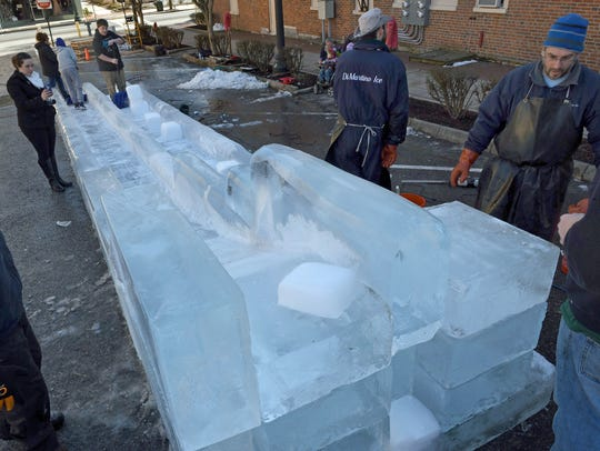 DiMartino Ice Company employees construct the popular