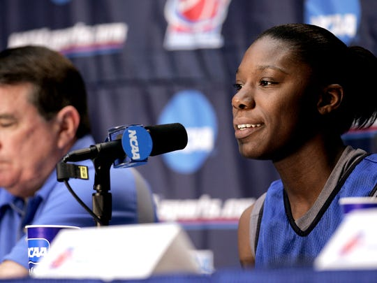 Middle Tennessee guard Chrissy Givens, right, smiles at a news conference as head coach Rick Insell, left, listens, Sunday, March 18, 2007, in Stanford, Calif., before their second-round game Monday against Marist in the NCAA women's basketball tournament. Middle Tennessee defeated Gonzaga 85-46 in the first round on Saturday. (AP Photo/Paul Sakuma)
