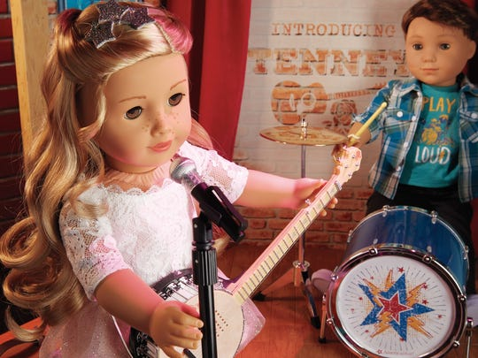 Tenney Grant, left, and American Girl's first boy doll,