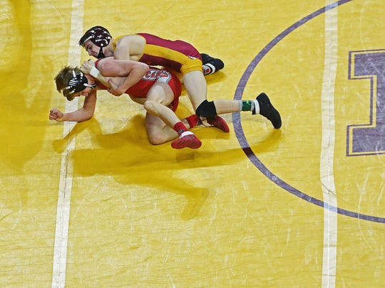 Roosevelt's Eli Kadoun, right, wrestles Rapid City Central's TJ Morrison in a Class A 113-pound quarterfinal match during the 2017 SDHSAA State Wrestling Championships Friday, Feb. 24, 2017, at the Denny Sanford Premier Center in Sioux Falls.