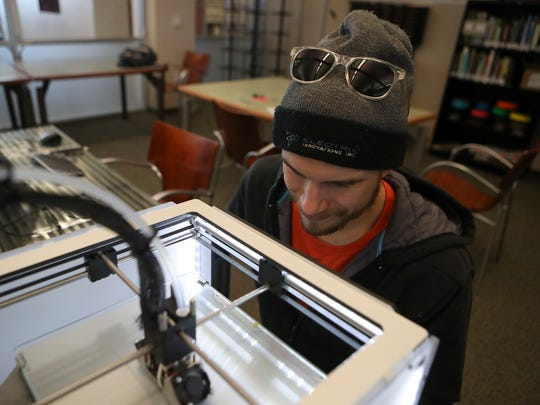 Edward Wall makes a prototype frame for glasses Thursday on a 3D printer at the Redding Library. Wall hopes to create a business that uses recycled plastic to create products.