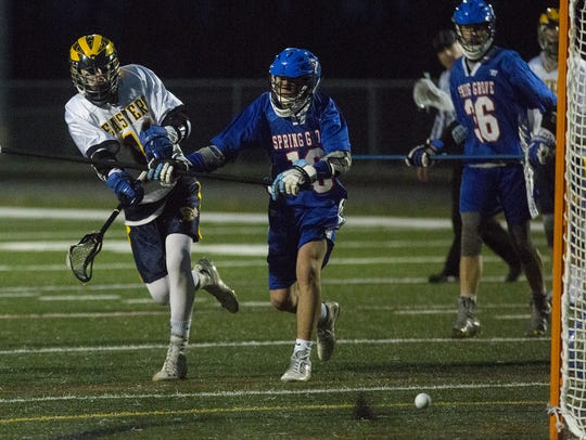 Eastern York's Zach Murray, left, scores a goal. Eastern