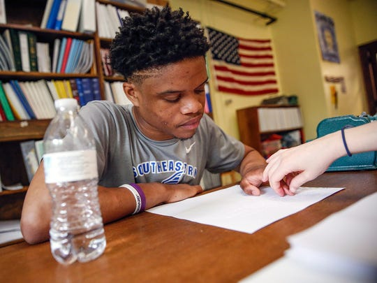 "Noah Malone, a freshman who splits his time between Hamilton Southeastern High School and the Indiana School for the Blind and Visually Impaired, works with teacher Emily Chodzko during a braille class on Thursday, May 18, 2017. ""I never thought I'd use braille,"" Malone said. ""It just seemed impossible to learn. It's been hard."""