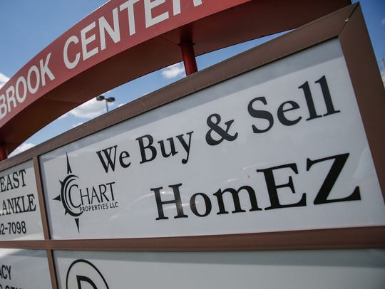 A sign for Chart Properties sits at 7440 Shadeland