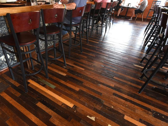 Jeff Bowers purchased the old flooring of the Dearborn courthouse and had it installed in his New Hudson Cafe.