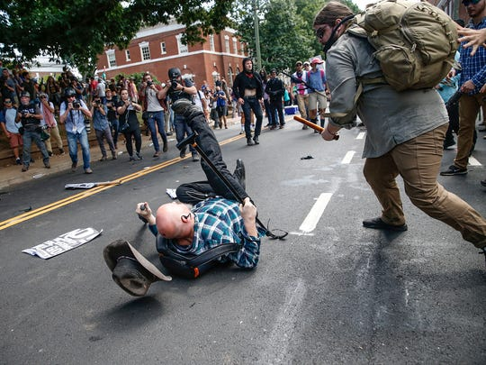 A white nationalist is knocked unconscious by a counter