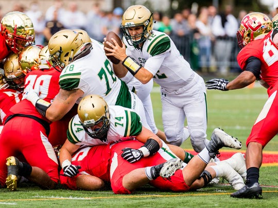 Nick Patti fights for yardage against Bergen Catholic High School on Sept. 30, 2017.