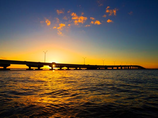 A Fort Myers to Cape Coral view of sunset over the Midpoint Memorial Bridge. The bridge opened Oct. 19, 1997.