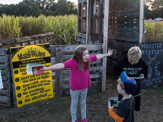 October 20, 2017 - Alaina Hubbard, 7, prepares her brothers for the monster mystery corn maze at Jones Orchard.