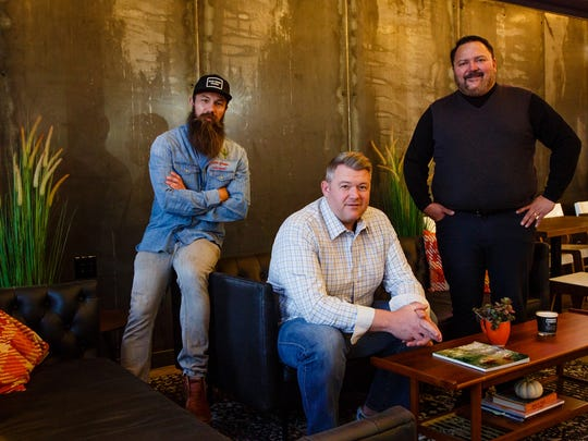 From left, Mixologist Jeff Naples, Purveyor of beer Brad Bormann and Restaurateur Nick Kuhn, pose for a portrait at The Hall inside The Foundry in Valley Junction on Tuesday, Oct. 24, 2017, in West Des Moines.