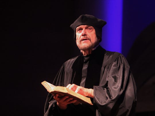"Dressed as Martin Luther, Clarence ""Bud"" Bence, a historian"