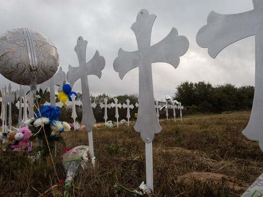 Crosses honoring the 26 killed at First Baptist Church sit in a field near a ball park in Sutherland Springs, Texas, on Tuesday, Nov. 7, 2017.