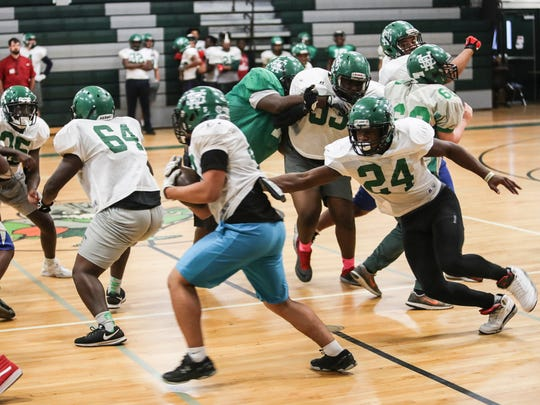November 08, 2017 - The White Station high school football team practices indoors for an upcoming game.