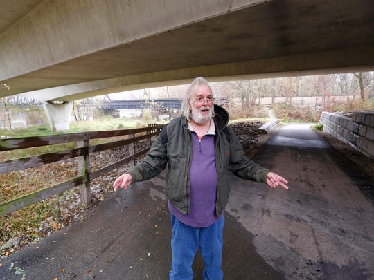 Steve Brackett walks along the Wabash Heritage Trail beneath the State Street bridge Wednesday, November 15, 2017, in West Lafayette. Brackett was homeless for about two years between 2014 and 2015. He lived just south of the bridge in the woods near the Wabash River. He said he often took shelter under the bridge, even bathing and washing clothes there as rain water would stream out of drain tiles.