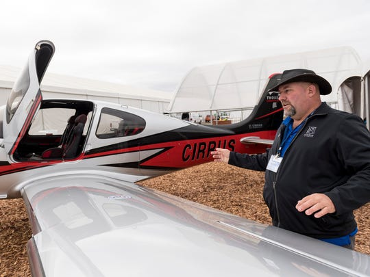 Dan Wahl of Cirrus Aircraft talks about the company's SR22T plane at the World Ag Expo at the International Agri-Center in Tulare on Monday, February 12, 2018.