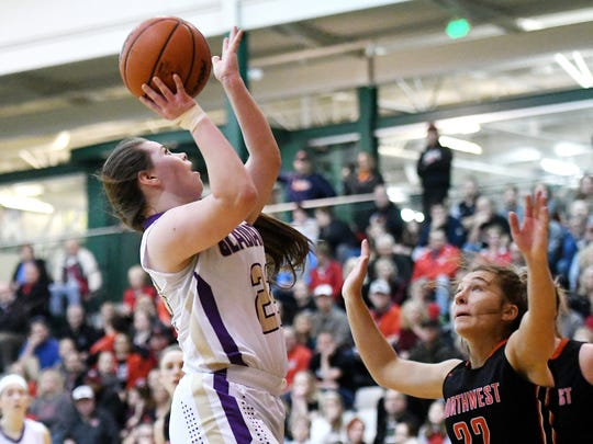 Fowlerville's Jackie Jarvis, left, shoots over Jackson