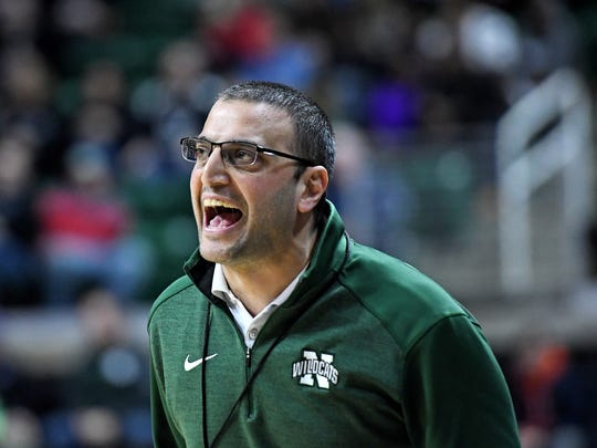 Novi's Brandon Sinawi calls out to his players during the fourth quarter on Friday, March 23, 2018, at the Breslin Center in East Lansing.