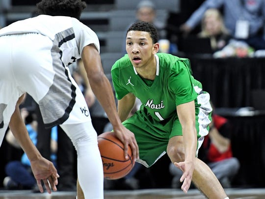 Novi's Trendon Hankerson, right, guards Holland West Ottawa's Xavier Wade during the fourth quarter on Friday, March 23, 2018, at the Breslin Center in East Lansing.