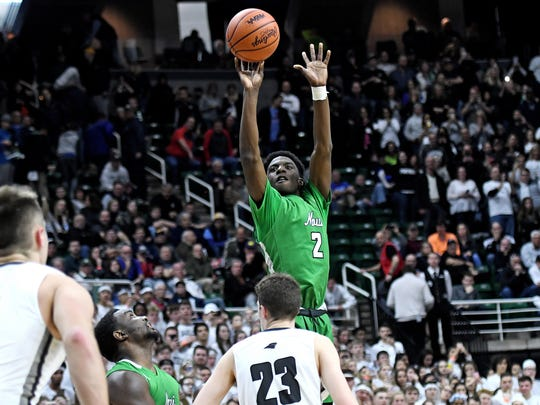 Novi's Traveon Maddox Jr. shoots during the fourth quarter on Friday, March 23, 2018, at the Breslin Center in East Lansing.