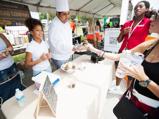 Demitria Henderson, 14, and her brother James Shannon of Breaking Bread Bakery, take part in Taste of the Cape at Four Freedoms Park earlier this year.