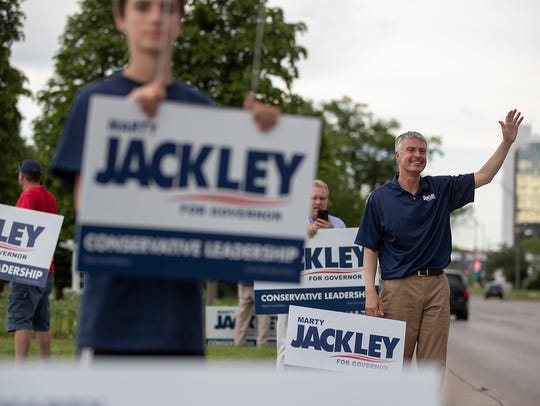 South Dakota Attorney General Marty Jackley  waves to passing motorists at Halley Park in Rapid City,  June, 2018.