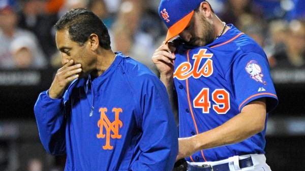 Mets pitcher Jonathon Niese, right, leaves the game with a trainer during the sixth inning against the Houston Astros on Friday night.