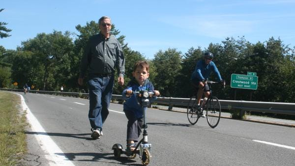 Walkers and kids on scooters share the Bronx River Parkway on Bike Sundays, which celebrates its 40th anniversary on Sept. 28.