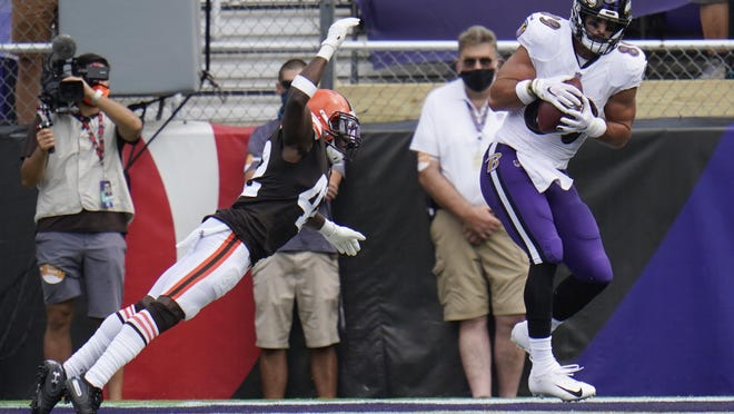 Baltimore Ravens safety Chuck Clark (36) grabs Cleveland Browns running back Kareem Hunt's (27) foot during the second half of an NFL football game, Sunday, Sept. 13, 2020, in Baltimore, MD.