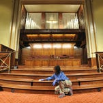 Galloway United Methodist Church employee Flo Jones cleans inside the church sanctuary Wednesday during ongoing renovations to the church in Jackson.
