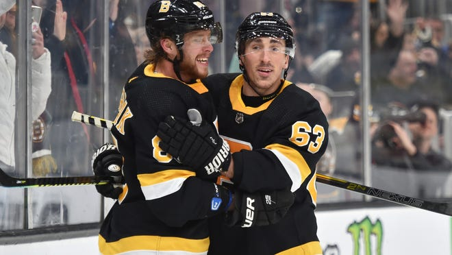Bruins David Pastrnak, left, and Brad Marchand are likely to miss the January start of the NHL season due to offseason surgeries.