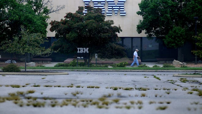 In this recent file photo, a man walks past the entrance to IBM Building 415, on IBM Road in the Town of Poughkeepsie.