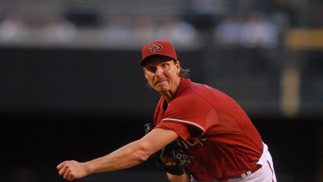 Diamondbacks pitcher (51) Randy Johnson pitches against the San Diego Padres at Chase Field in Phoenix, AZ.