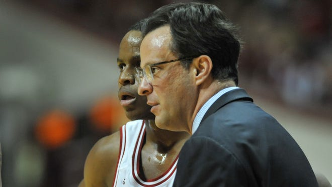 Indiana coach Tom Crean talks to player Yogi Ferrell on the sidelines, as Nebraska defeated Indiana 70-60 at Assembly Hall in Bloomington Wednesday March 5, 2014.