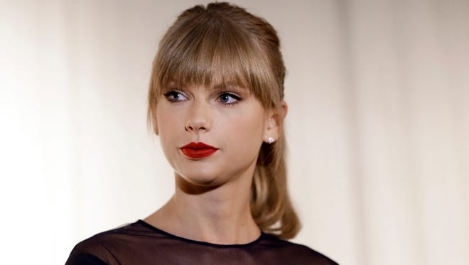 FILE - In this Oct. 12, 2013 file photo, Taylor Swift appears at the Country Music Hall of Fame and Museum in Nashville, Tenn. David Mueller, a former radio host, claims in a lawsuit that he lost his job because Swift falsely accused him of groping her. Swift has countersued, alleging she's the victim of sexual assault. Mueller is seeking up to $3 million in damages at the trial that begins Monday, Aug. 7, 2017, in federal court in Denver. Both sides say no settlement is in the works. (AP Photo/Mark Humphrey, File)