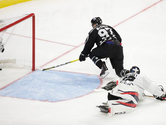 Pacific Division's Connor McDavid, top, of the Edmonton Oilers, scores against Metropolitan Division goalie Sergei Bobrovsky, of the Columbus Blue Jackets, during the NHL hockey All-Star championship game, Sunday, Jan. 29, 2017, in Los Angeles. (AP Photo/Jae C. Hong)