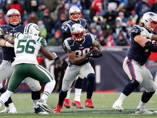 New England Patriots running back Brandon Bolden (38) runs during the second half of New England's 26-6 win over the New York Jets at Gillette Stadium. Bolden played at Ole Miss.