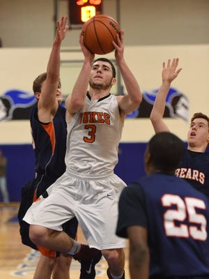 Marlboro High School's Tyler Jollie takes a floater during a Class B regional semifinal against Briarcliff at Mount Saint Mary College in Newburgh on March 2.