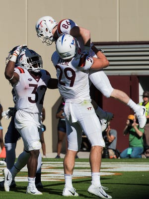 Sep 23, 2017; Blacksburg, VA, USA; Virginia Tech Hokies wide receiver C.J. Carroll (86) celebrates after scoring a touchdown with tight end Dalton Keene (29) and running back Steven Peoples (32) during the second half against the Old Dominion Monarchs at Lane Stadium. Mandatory Credit: Lee Luther Jr.-USA TODAY Sports