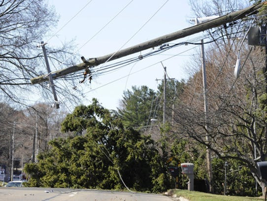 A tree and a snapped power pole closed Spring Arbor
