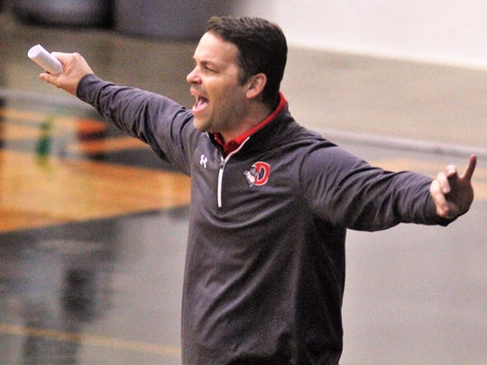 Dixie Heights head coach Joel Steczynski instructs his team during Dixie Heights' 53-47 girls basketball win at Newport Central Catholic Dec. 6, 2017 in Newport KY.
