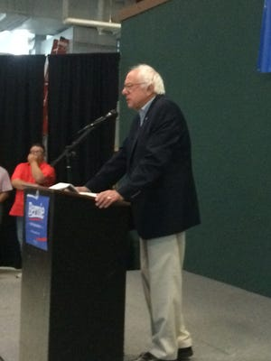 Sen. Bernie Sanders, I-Vt., speaks to a crowd of over 300 in the social hall of the Robert A. Lee Recreation Center, with over 100 more outside in the hall, in Iowa City Saturday morning.