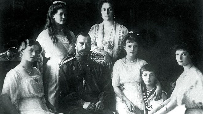 This 1914 file photo shows Russian Czar Nicholas II (C-L) with his wife Tsarina Alexandra (Top, right) his four daughters and son. Eighty years after Russia's last Tsar and his family were executed, their much-disputed bones were to be placed in small wooden coffins 15 July and readied for a state burial alongside their royal ancestors. R
